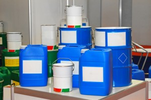 Blue barrels and buckets of chemical substance